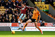 Burnley midfielder David Jones and Wolverhampton Wanderers midfielder Dave Edwards battle during the Sky Bet Championship match between Wolverhampton Wanderers and Burnley at Molineux, Wolverhampton, England on 7 November 2015. Photo by Alan Franklin.