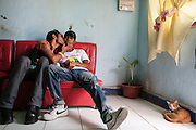 Tuta and Abrao in Melody's salon in Dili. 1 October 2009