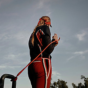 Pitcher, Monica Abbott, stretches before the game.<br /> <br /> Todd Spoth for The New York Times.