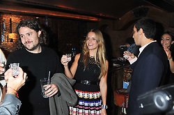 ADAM WAYMOUTH and, EUGENIE NIARCHOS at a party to celebrate the opening of the Muzungu Sisters Pop Up Store at Momo - an ethically sourced fashion brand  held at Momo, 25 Heddon Street, London on 27th October 2011.