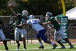 17 September 2011: Derek DiNino puts pressure on Rob Gallik during an NCAA Division 3 football game between the Aurora Spartans and the Illinois Wesleyan Titans on Wilder Field inside Tucci Stadium in.Bloomington Illinois.