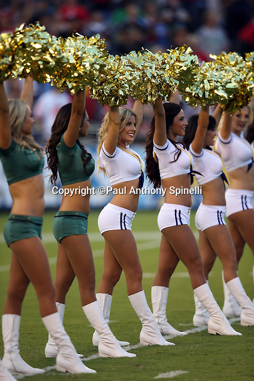 The San Diego Chargers cheerleaders wave pom poms as they cheer for the team during a dance routine during the NFL week 4 preseason football game against the San Francisco 49ers on Thursday, Aug. 29, 2013 in San Diego. The 49ers won the game 41-6. ©Paul Anthony Spinelli