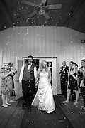 Bride and Groom with bubbles. Wedding took place at Samuel Cedars in Springfield, MO.