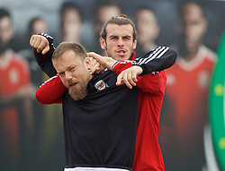 DINARD, FRANCE - Sunday, July 3, 2016: Wales' Gareth Bale play wrestles with Jamie Benito Plans during a training session at their base in Dinard as they prepare for the Semi-Final match against Portugal during the UEFA Euro 2016 Championship. (Pic by David Rawcliffe/Propaganda)