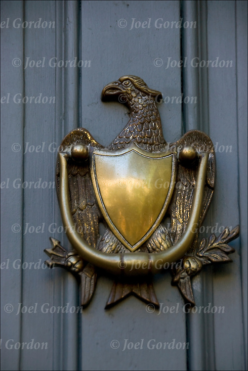 Decorative and functional brass door knocker at 232 E 10th Street in Greenwich Village.