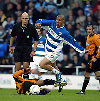 Photograph: Scott Heavey<br />Reading V Wolverhampton Wanderers. 14/05/2003.<br />James Harper skips over a tackle from Paul Ince during this Natinwide Division one playoff Semi-final, second leg match at the Madjeski Stadium.