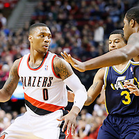 06 December 2013: Portland Trail Blazers point guard Damian Lillard (0) drives past Utah Jazz point guard Trey Burke (3) during the Portland Trail Blazers 130-98 victory over the Utah Jazz at the Moda Center, Portland, Oregon, USA.
