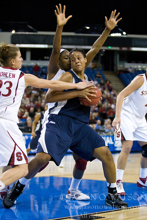 March 29, 2010; Sacramento, CA, USA; Xavier Musketeers center Ta'Shia Phillips (53) is defended by Stanford Cardinal guard Jeanette Pohlen (23) and forward Nnemkadi Ogwumike (30) during the second half in the finals of the Sacramental regional in the 2010 NCAA womens basketball tournament at ARCO Arena. Stanford defeated Xavier 55-53.