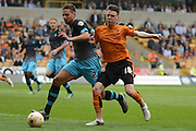 Sheffield Wednesday defender Vincent Sasso and Wolverhampton Wanderers striker Joe Mason battle for the ball during the Sky Bet Championship match between Wolverhampton Wanderers and Sheffield Wednesday at Molineux, Wolverhampton, England on 7 May 2016. Photo by Alan Franklin.