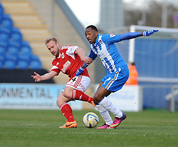 Bristol City's Simon Gillett challenges Colchester United's Sanchez Watt  - Photo mandatory by-line: Dougie Allward/JMP - Mobile: 07966 386802 22/03/2014 - SPORT - FOOTBALL - Colchester - Colchester Community Stadium - Colchester United v Bristol City - Sky Bet League One