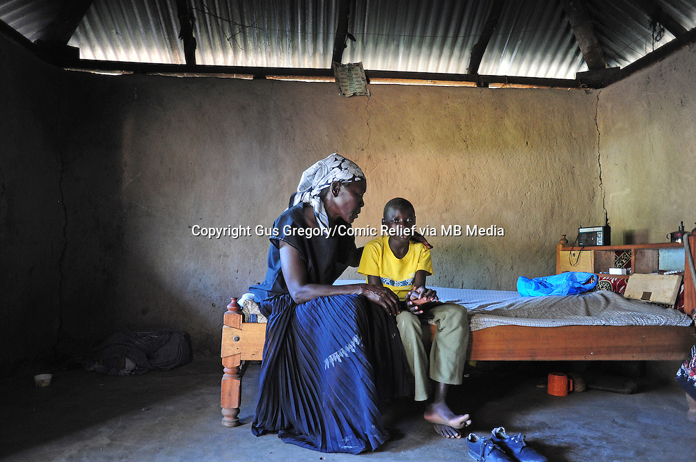 LYDIA WITH HER GRAN, HER MOTHER JUST DIED OF HIV/ MAL NUTRITION