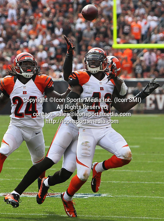 September 29, 2013 - Cleveland, OH, USA - Cleveland Browns wide receiver Josh Gordon, behind, stops Cincinnati Bengals safety George Iloka from intercepting a pass at FirstEnergy Stadium in Cleveland, Ohio, on Sunday, September 29, 2013. The Browns won, 17-6