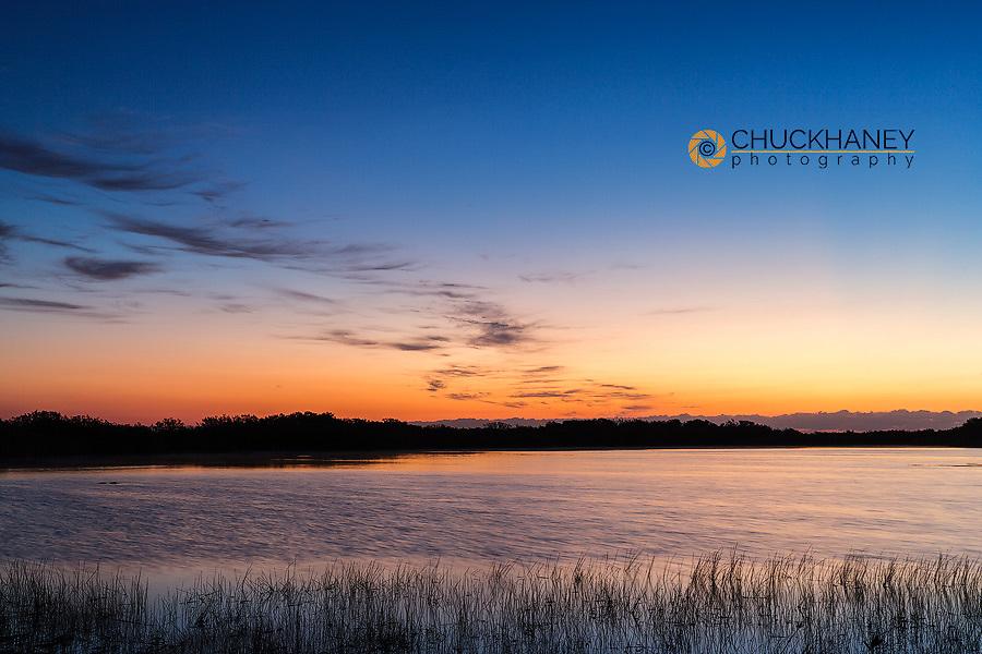 Sunrise clouds reflect into Nine Mile Pond in Everglades National Park, Florida, USA