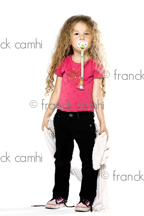 caucasian little girl holding blanket with pacifier isolated studio on white background