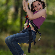 a little girl on tree climing activity  at Lac d'Aubusson