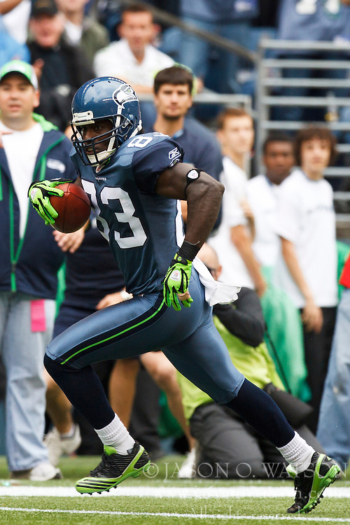 September 26, 2010; Seattle, WA, USA;  Seattle Seahawks wide receiver Deion Branch (83) rushes up field after a pass reception against the San Diego Chargers during the second quarter at Qwest Field. Seattle defeated San Diego 27-20.