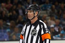 Jan 19, 2012; San Jose, CA, USA; NHL referee Greg Kimmerly (18) before a face off between the San Jose Sharks and the Ottawa Senators during the second period at HP Pavilion. Ottawa defeated San Jose 4-1. Mandatory Credit: Jason O. Watson-US PRESSWIRE