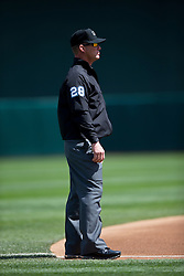 OAKLAND, CA - APRIL 09:  MLB umpire Jim Wolf #28 stands in the infield during the first inning between the Oakland Athletics and the Texas Rangers at O.co Coliseum on April 9, 2015 in Oakland, California. The Texas Rangers defeated the Oakland Athletics 10-1. (Photo by Jason O. Watson/Getty Images) *** Local Caption *** Jim Wolf