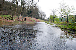 Water that feeds into the overflowing Derwent Dam in the Peak National Park spills across roads as part of of Britain still have a hosepipe ban in place despite the possibility that April 2012 could be the wettest in 250 years..27 April 2012 .Image © Paul David Drabble