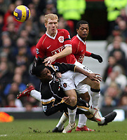 Photo: Paul Thomas.<br /> Manchester United v Charlton Athletic. The Barclays Premiership. 10/02/2007.<br /> <br /> Paul Scholes of Man Utd crashes into Alexandre Song (L).