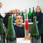 Séverine Frerson prepares to take over the role of cellar master from Hervé Deschamps (L) at champagne Perrier-Jouët. Deputy cellar master Eric Trichet is mixing the wines. 