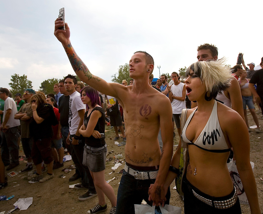 Spectators and fans watch the many bands and other attractions as they try to stay cool at the Van's Warped Tour stop at the Utah State Fair Park in Salt Lake Cityi, Utah Saturday July 7, 2007.  August Miller/ Deseret Morning News