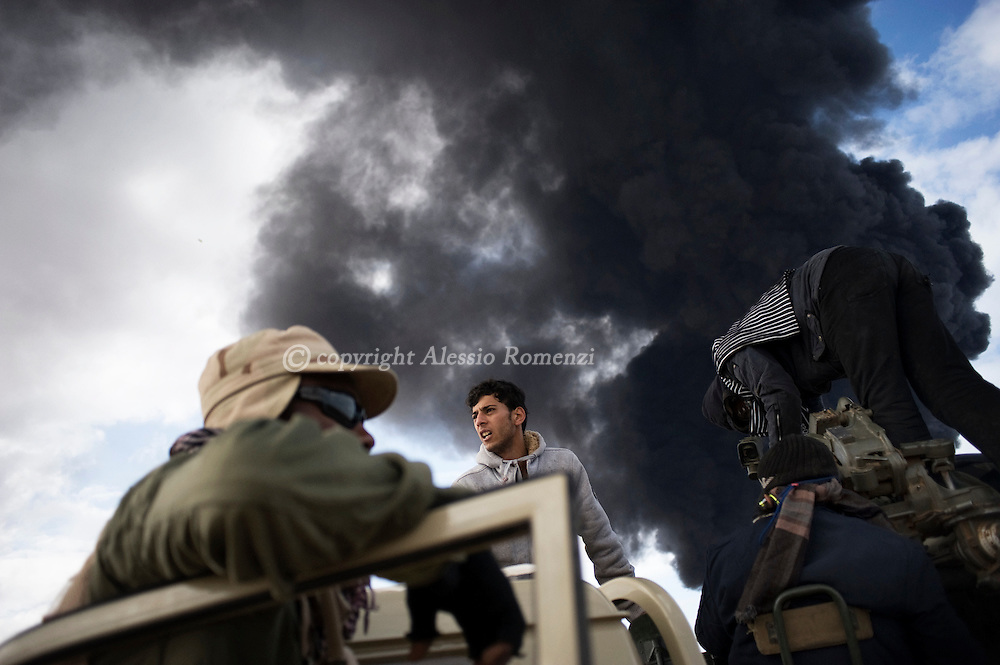 LIBYA, BIN JAWAD: Rebels during the fighting between anti and pro-Gadafy troupes, on March 11, 2011. ALESSIO ROMENZI