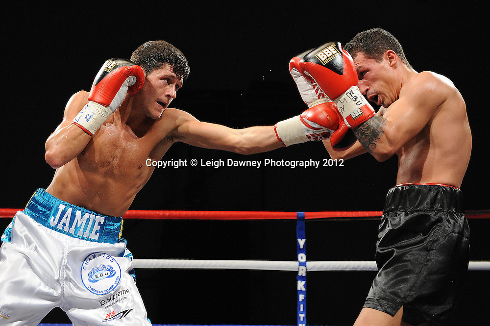 Jamie McDonnell (white shorts) defeats Ivan Pozo for the European Bantamweight Title, on 3rd March 2012 at the Hillsborough Leisure Centre. Frank Maloney & Dennis Hobson Promotions © Leigh Dawney Photography 2012.Jamie McDonnell (white shorts) defeats Ivan Pozo for the European Bantamweight Title, on 3rd March 2012 at the Hillsborough Leisure Centre. Frank Maloney & Dennis Hobson Promotions © Leigh Dawney Photography 2012.Jamie McDonnell (white shorts) defeats Ivan Pozo for the European Bantamweight Title, on 3rd March 2012 at the Hillsborough Leisure Centre. Frank Maloney & Dennis Hobson Promotions © Leigh Dawney Photography 2012.Jamie McDonnell (white shorts) defeats Ivan Pozo to retain the European Bantamweight Title, on 3rd March 2012 at the Hillsborough Leisure Centre. Frank Maloney & Dennis Hobson Promotions © Leigh Dawney Photography 2012.