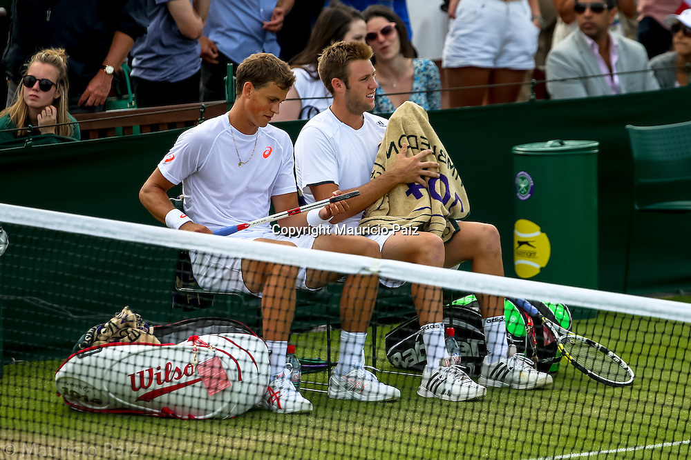 LONDON, ENGLAND - JUNE 26: Player of Country explain Gentlemen's Singles first round match against player of country on day four of the Wimbledon Lawn Tennis Championships at the All England Lawn Tennis and Croquet Club at Wimbledon on June 25, 2014 in London, England.