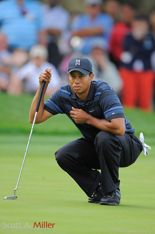 March 27, 2009; Orlando, FL, USA; Tiger Woods lines up a putt on the 11th hole during the second round of the Arnold Palmer Invitational at the Bay Hill Club and Lodge. ©2009 Scott A. Miller