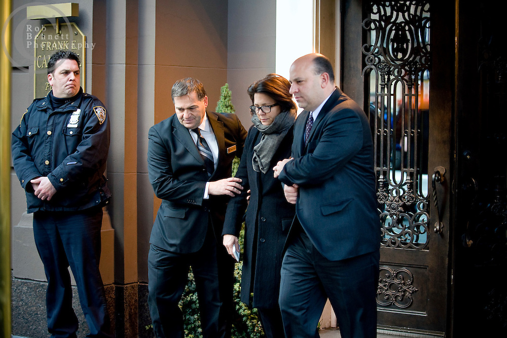 """Wed Jan 4, 2011: Woman believed to be Madonna Badger is escorted out of the Frank E. Campbell funeral home.  Credit: Rob Bennett for The Wall Street Journal***IF USED BY NBC (per terms of agreement) image must be prominently credited as: """"Courtesy The Wall Street Journal""""***"""