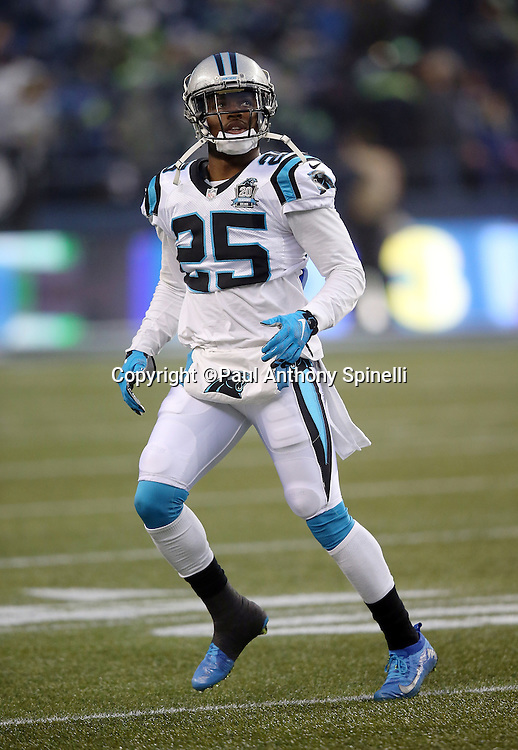Carolina Panthers cornerback Bene' Benwikere (25) chases the action while warming up before the NFL week 19 NFC Divisional Playoff football game against the Seattle Seahawks on Saturday, Jan. 10, 2015 in Seattle. The Seahawks won the game 31-17. ©Paul Anthony Spinelli
