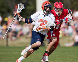 Virginia Cavaliers M/A Steve Giannone (5) runs past Cornell Big Red M Peter Grom (9).  The #1 ranked Virginia Cavaliers defeated the #4 ranked Cornell Big Red 14-10 at Klockner Stadium on the Grounds of the University of Virginia in Charlottesville, VA on March 8, 2009.