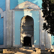 Entrance portal of the Green Tomb or Yesil Turbe, mausoleum of the 5th Ottoman Sultan Mehmed I Celebi, Bursa, Turkey. It was built by Mehmed's son and successor Murad II following Mehmed's death in 1421 and is so named because of the green-blue tiles which cover the exterior. The architect, Haci Ivaz Pasha, designed the tomb and the Yesil Mosque opposite. Most of the exterior tiles were replaced following an earthquake in 1855. Picture by Manuel Cohen