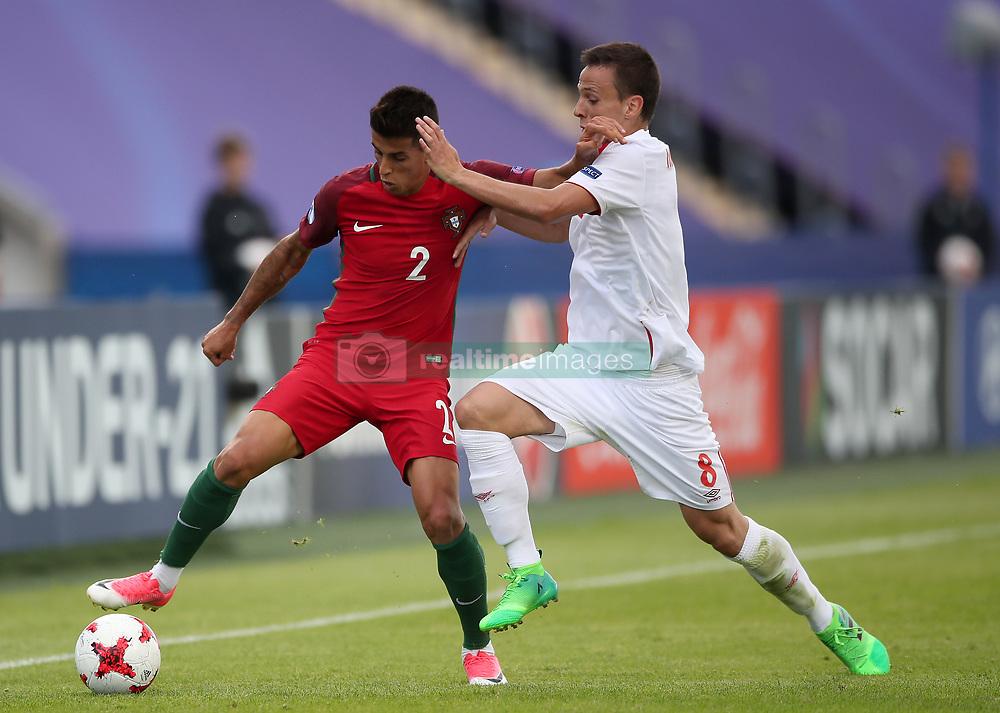 Portugal's Joao Cancelo (left) and Serbia's Nemanja Maksimovic (right) battle for the ball