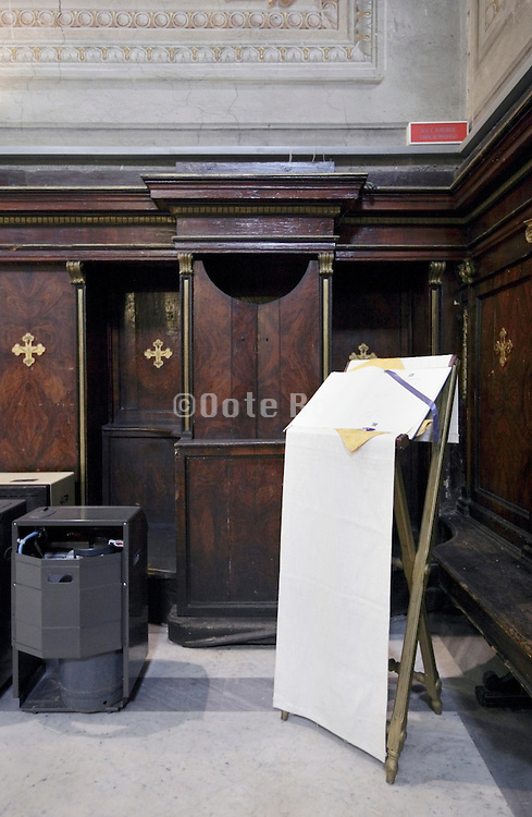 confession box with gas bottle and large book on as stand