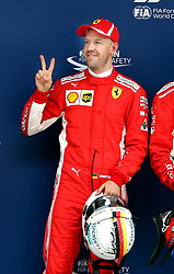 SHANGHAI, April 14, 2018  First-placed Ferrari's driver Sebastian Vettel of Germany poses for photos after the qualifying of Formula 1 2018 Chinese Grand Prix in Shanghai, east China, April 14, 2018.  dx) (Credit Image: © Fan Jun/Xinhua via ZUMA Wire)
