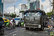 14 MAY 2010 - BANGKOK, THAILAND: A wrecked Thai army riot control truck at the intersection of Rama IV and Witthayu Roads in Bangkok Friday morning. The truck was captured and vandalized by anti government protesters. Tensions among Red Shirt protesters demanding the dissolution of the current Thai government rose overnight after Seh Daeng, the Red Shirt's unofficial military leader was shot in the head by a sniper. Gangs of Red Shirts have taken over military checkpoints on Rama IV and are firing small rockets at military helicopters and army patrols in the area. Troops have responded by firing towards posters.  PHOTO BY JACK KURTZ