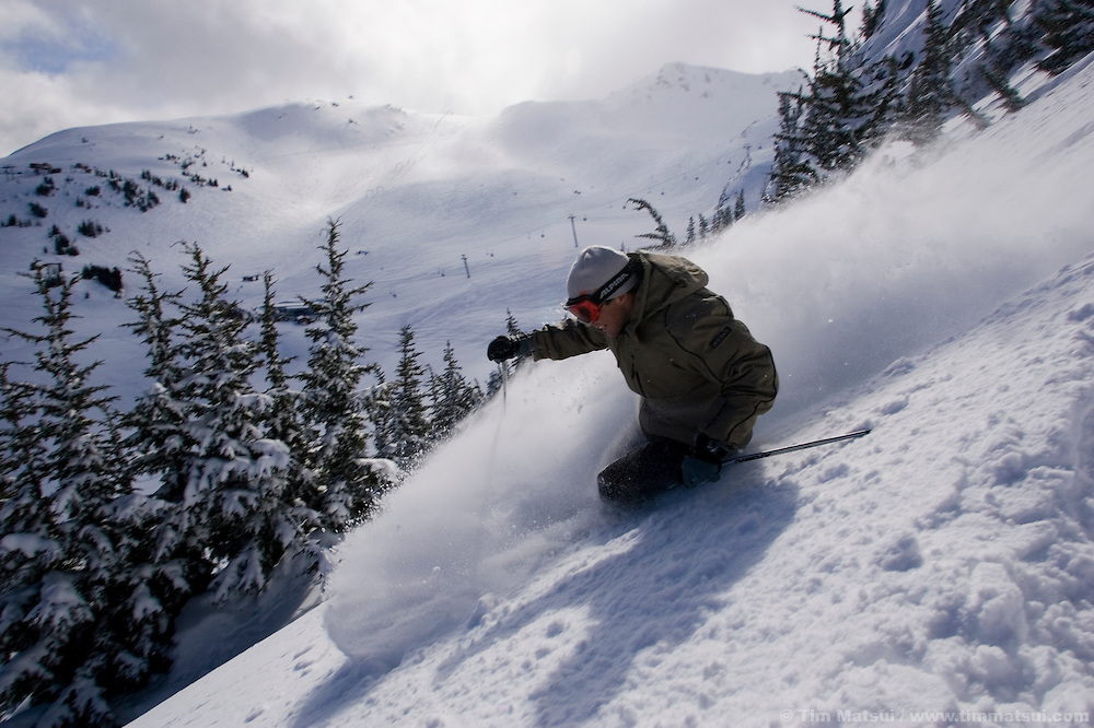 Athlete and businessman Dana Williams skies at Whistler-Blackcomb ski resort in British Columbia, Canada.