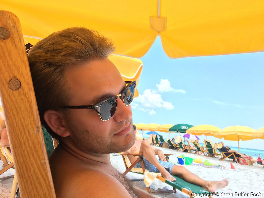 Millennial male enjoying a Gulf Coast Vacation.