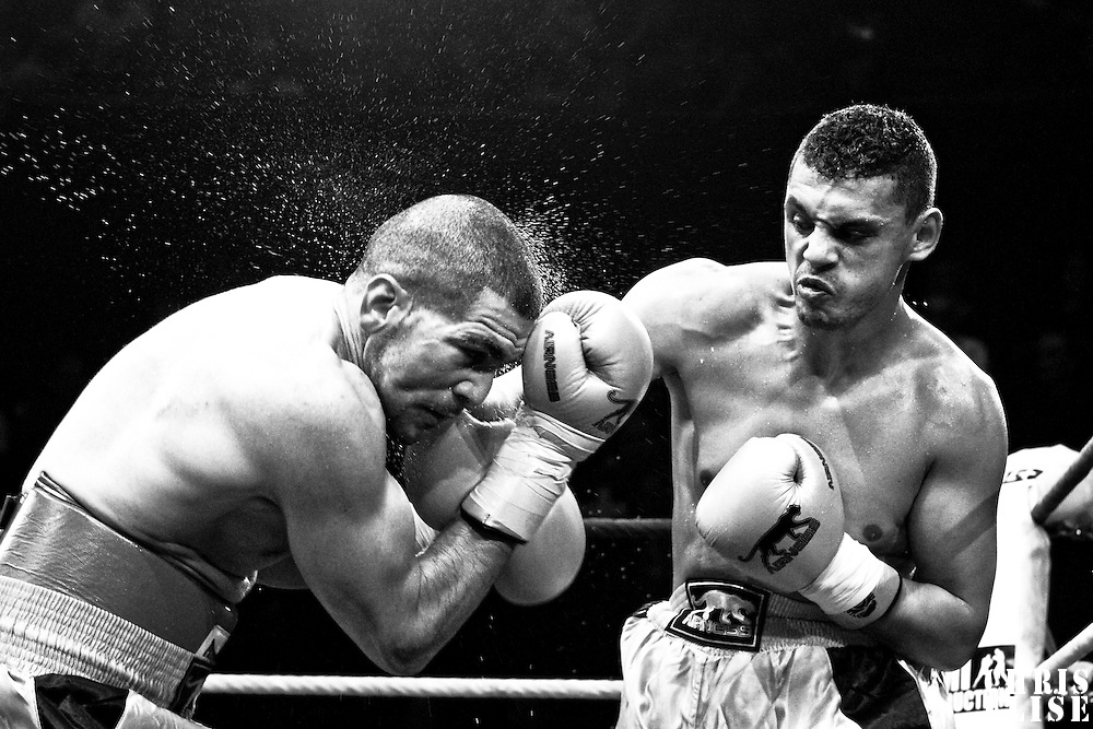 19 November 2009: Fight between Djamel Selini (left) and Tarik Khaidouri (right) during the Grand Tournoi boxing semi finals event at Cirque d'Hiver in Paris, France..