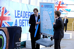 © Licensed to London News Pictures. 04/10/2011. MANCHESTER. UK. Conservative Party staff move a sign at The Conservative Party Conference at Manchester Central today, October 4, 2011. Photo credit:  Stephen Simpson/LNP
