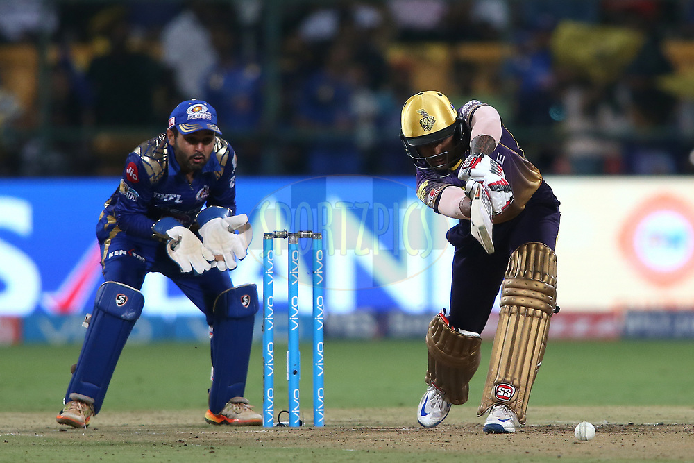 Suryakumar Yadav of the Kolkata Knight Riders drives a delivery during the 2nd qualifier match of the Vivo 2017 Indian Premier League between the Mumbai Indians and the Kolkata Knight Riders held at the M.Chinnaswamy Stadium in Bangalore, India on the 19th May 2017<br /> <br /> Photo by Shaun Roy - Sportzpics - IPL