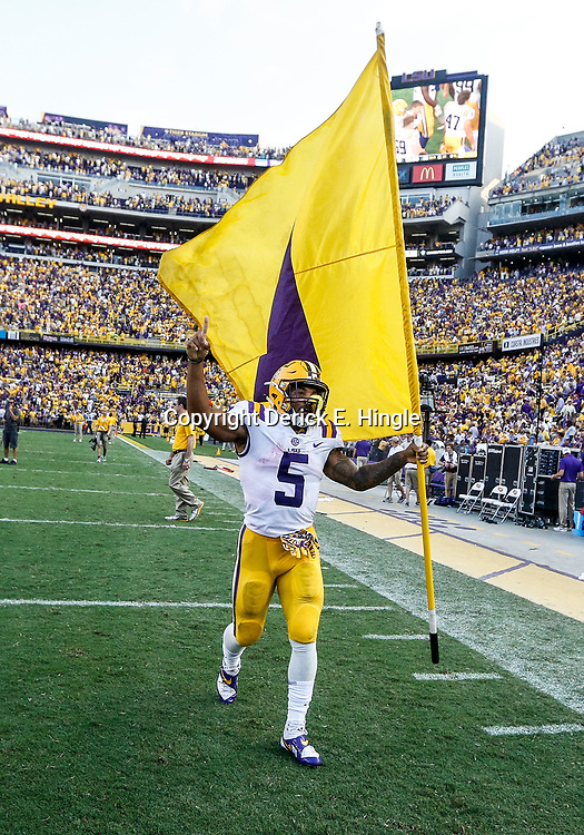 Oct 14, 2017; Baton Rouge, LA, USA; LSU Tigers running back Derrius Guice (5) celebrates with a flag after a win against the Auburn Tigers in a game at Tiger Stadium. LSU defeated Auburn 27-23. Mandatory Credit: Derick E. Hingle-USA TODAY Sports