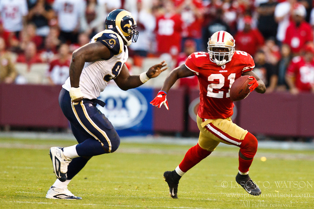 November 14, 2010; San Francisco, CA, USA;  San Francisco 49ers running back Frank Gore (21) rushes past St. Louis Rams defensive end James Hall (96) during overtime at Candlestick Park. San Francisco defeated St. Louis 23-20 in overtime.