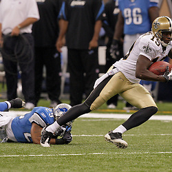 2009 September 13: New Orleans Saints wide receiver Devery Henderson (19) escapes a tackle by Detroit Lions cornerback Eric King (29) during a 45-27 win by the New Orleans Saints over the Detroit Lions at the Louisiana Superdome in New Orleans, Louisiana.