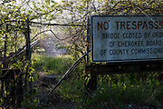Tahlequah, OK - A sign and old gate blocks access to a closed bridge over the Illinois River east of Tahleqhah.