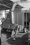 """29/04/1962<br /> 04/29/1962<br /> 29 April 1962<br /> Farm machinery at the R.D.S. Spring Show, Ballsbridge Dublin, feature with Julian Bayley for Farming Express. Image shows a """"Hojme"""" forage harvester."""