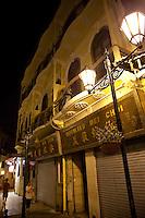 Classic old colonial Portuguese architecture line the cobblestone streets in Macau.