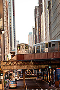 "Trains of the Chicago rapid transit system known as the""L""  pass over head in the LOOP district in Chicago, IL, USA."